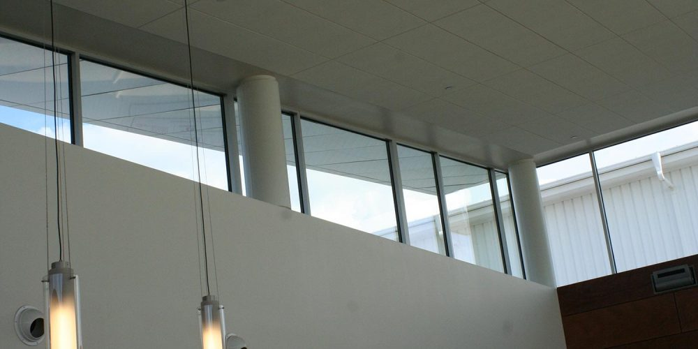 View of upper part of Hawker Beechcraft lobby, showing line of large exterior windows