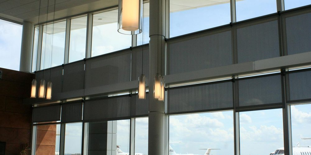 Interior view of Hawker Beechcraft lobby, looking out front window wall to tarmac with waiting planes